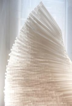 paper wing comprised of thousands of strips of recycled tissue paper | Artist: Nathalie Boutté - http://www.nathalieboutte.com