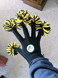 Great idea...wriggle your gloves in the air for your football team! This is clever! And though it pains me to pin these Steeler colors, this is a great idea for any team you suppport!