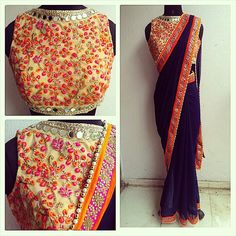 Mirror work and embroidery mix sari in navy blue. Orange and pink accents.