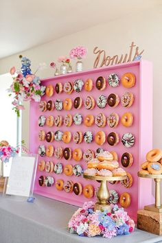 A framed peg board is the perfect spot to hang some delicious doughnuts.