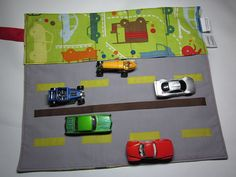 toy car wallet, stores 5 cars and is a play mat when unrolled, genius  no more loose cars rattling around in my purse!