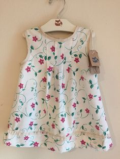 A personal favorite from my Etsy shop https://www.etsy.com/listing/507265692/handmade-girl-dress-vintage-sundress