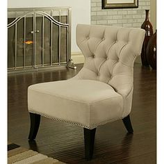 Add distinctive style to your home decor with this light cream microsuede chair. Espresso legs, a high-density foam fill and curved tufted backs complete the unique style of this chair.