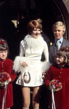 In 1968 British entertainer Cilla Black married her manager Bobby Willis in a London civil ceremony wearing a crimson red velvet mini dress then donned a white mini dress trimmed with feathers for...