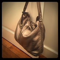 Pewter Michael Kors bag Beautiful condition! Michael Kors hobo style shoulder bag with studded detail. Incredible soft leather. Hardly any signs of wear inside or out. MICHAEL Michael Kors Bags Shoulder Bags