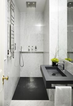 In The Master Bathroom, Traditional Statuary Marble Is Juxtaposed With A  Black Corian For A Clean, Masculine Look. Interior Designer ...