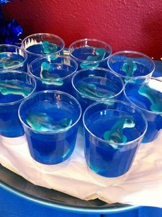 Under the Sea Party food ideas. Also fun for Mermaid parties. Jell-o cups with shark gummies.