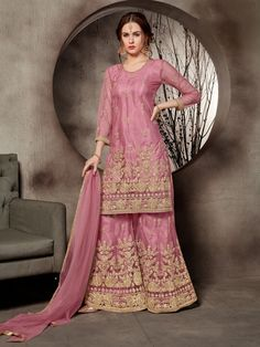Latest Pink Color Net Embroidered Pakistani Sharara Suit Description: Fabric of this suit is net. Comes along with a santool inner, net sharara and net dupatta. Sharara suit is semi stitch. This suit has embroidered work. Ideal for parties, wedding Sharara Suit, Salwar Kameez, Salwar Suits, Patiala, Designer Wear, Designer Dresses, Costume Gris, Suits For Women, Clothes For Women