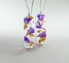 Real flower earrings, Resin dangle earrings, Purple earrings, Valentines gift, Unusual earrings, Terrarium jewellery, Nature lover gift by CosmicLensJewellery on Etsy https://www.etsy.com/uk/listing/583191859/real-flower-earrings-resin-dangle