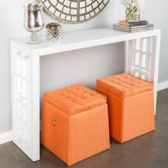 """Console table with latticework sides.  Product: Console tableConstruction Material: Wood and glassColor: WhiteDimensions: 32"""" H x 50"""" W x 12"""" DNote: Ottomans not included"""