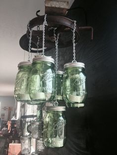 Green Mason Jar Chandelier made from an old well pully #repurpose #handcrafted #etsy #southernpendants #masonjar #lighting #country #decor