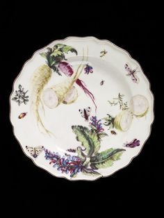 Plate ca. 1755   Chelsea Porcelain factory   Plate with wavy edge. Painted with a spray of a large-leafed plant with crimson and lavender flowers, sliced parsnips, beetroots and turnips, and small moths and beetles.