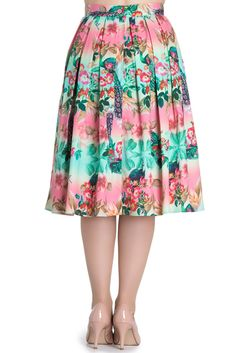Printed skirt. Print features peacocks and flowers on pink and green background. Waistband in self fabric. Zip in the centre back to fasten. Button on the back