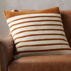 "Shop 20"" division rust pillow.   Upcycled yarn spins a fresh color story in a nubby, earthy weave of rust/natural stripes.  Wide rust border on one end keeps things unpredictable.  Cotton/acrylic pillow flips to 100% cotton in natural."