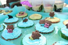 """The cupcakes were decorated with buttercream frosting and I made the bear-wear from marzipan purchased from the supermarket. Just roll them out with a small rolling pin and cut shapes out with a sharp knife."""