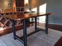 Industrial Table with Slab Top by Woodland Creek. Available in custom sizes.
