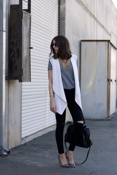 white vest | grey tee | black ripped jeans | snakeskin heels | statement bib necklace // Elements of Ellis