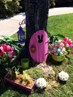 A welcoming portal for the Easter bunny to enter your yard from his rabbit hole. First, cut out a foam core door and paint it to create a faux wood effect. Then, add the hardware, such as a knob and hinges. Last attach the door to a tree trunk.