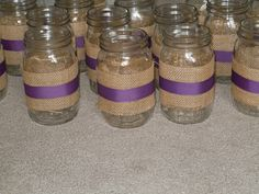 Mason Jar with Burlap and ribbon! Using for my center piece at my wedding!