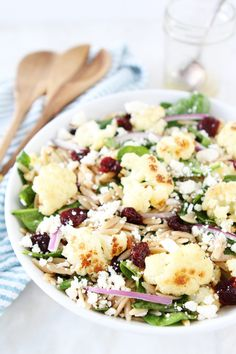 Roasted Cauliflower, Feta, and Orzo Salad Recipe on twopeasandtheirpod.com Spinach salad with roasted cauliflower, orzo, feta cheese, dried cherries, red onion, and a simple honey lemon dressing.
