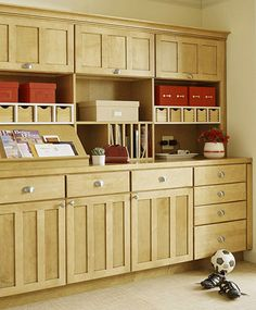 Hide Clutter Behind Cabinetry--could be good along window wall for game storage, etc. (bhg.com)