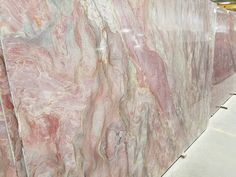 Volcano Fusion is a quartzite the comes from Brazil. This dramatic multi-color stone has unique coloration. Waves of pastel greens, blues, pink, rose, and purplish hues with ink colored black in the veins. With high movement this stone is reminiscent of a cooling volcano. This stone is perfect for a kitchen countertop, bath vanity or accent wall.