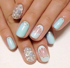 Obsessed with these nails. Light blue with  3-D seashell detailing.