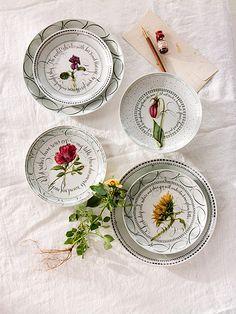 Botanics and calligraphy on fine china by Maria Thomas