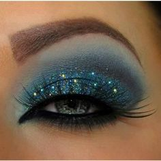 Smokey, gorgeous, and blue right down to the glitter. Love it! #makeup #beauty #lashes #smokeyeye