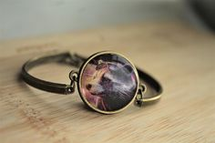 Handcrafted Rocket Raccoon bracelet.  Made by hand from a Guardians of the Galaxy comic book. I use all the pages from the book that I can and recycle the rest.