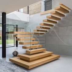 floating stairs Bespoke oak and glass staircase with floating treads and structural glass handrail for a new build property on the outskirts of Leeds Staircase Design Modern, Home Stairs Design, Floating Staircase, Staircase Railings, Modern Stairs, Modern House Design, Staircase Ideas, Stair Design, Glass Stairs Design