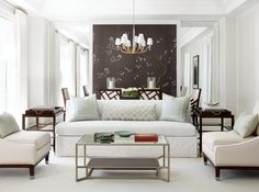 To make this elegant living room memorable, designer Brian Gluckstein mounted a panel of black Fromental wallpaper dotted with hand-embroidered silk flowers. Condo Living, Home Living Room, Living Room Decor, Living Area, Black Walls, White Walls, Cute Home Decor, Home Interior Design, Interior Ideas