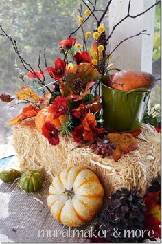 I Love these  hay bails for fall decoration !  as well as the greenery, the beautiful green bucket...these are wonderful colors...grab a pail of any color and PAINT it !