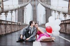 Love the pose + balloons + scenery + the juxtaposition between the rusty bridge parts and the sweet pink