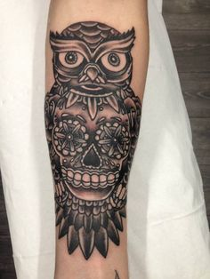 Lovely owl tattoo done by Nathan