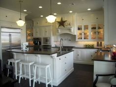 chocolate/espresso island with whitish top and white cabinets with chocolate/espresso top.