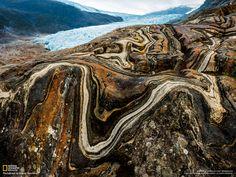 Contorted stone beside Engabreen glacier in Norway.