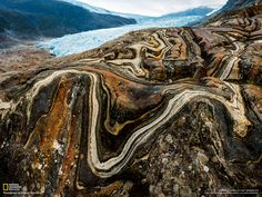 Contorted stone beside Engabreen glacier in Norway.