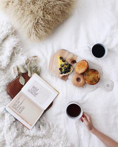 Coffee pastries and a good book in bed this morning fueling up for a fun day ahead!  We'll be hanging out at the @coach trunk show today at @scottsdalefashionsquare from 1-4pm. Hope to see some of you there! (RSVP link in profile.) by newdarlings