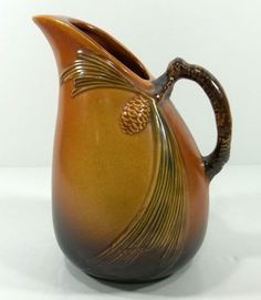 "Roseville ""Pinecone "" Pitcher c1935 - liveauctioneers.com"
