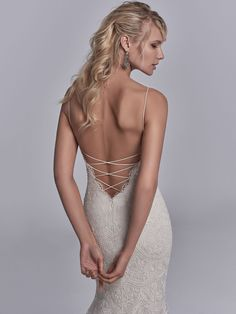 Sottero and Midgley - MAXWELL ROSE, Allover lace motifs drift over tulle and Inessa Jersey in this sexy fit-and-flare wedding dress, accenting the illusion triple-tiered train. Spaghetti straps glide from the V-neckline to crisscross strap details over the plunging back. Finished with zipper closure.