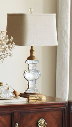 Très chic. Our Parisian Glass Lamps are old-world couture, with a striking silhouette and sophisticated sense of style.