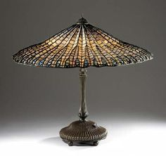 Louis Comfort Tiffany (1848-1933) - Lotus Table Lamp. Bronze with Leaded Glass Shade. Circa 1910.