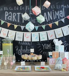 Alphabet Baby Shower with Watercolor Animal Alphabet Fabric Garland by Wonderful Collective:  love the hanging fabric blocks, printed ABC block gift goxes and fabric animal treat bags
