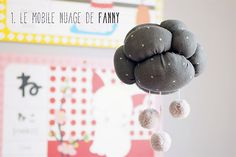 Create a wonderful cloud mobile with this simple tutorial & free pattern from Petit Poulou.