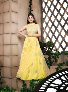 Look Stylish in evening party by draping this stunning yellow shaded sleeveless Party Wear Ethnic Anarkali Gown which has been adorned with marvellous embroidery. Anarkali Frock, Long Anarkali, Anarkali Suits, Lehenga Suit, Designer Anarkali, Designer Gowns, Indian Wedding Outfits, Indian Weddings, Indian Outfits