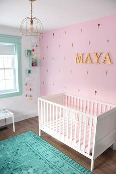 Decorating a baby girls nursery? Looking for nursery decor ideas? This mint, pink and gold room is all kinds of sweet with tons of DIY project ideas and budget-friendly decor items. Click over for all the sources and project tutorials!