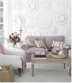 Add texture to walls... not sure how they did this one, but you could just mold things on - or hang clay creations and paint it all white. Very fun with the light colors in the room!