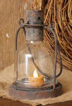 Rustic candle lantern....sooo prim!   I'd use a small chunky candle and prim it up a little... Antique Lanterns, Candle Lanterns, Hurricane Lamps, Lantern Lamp, Led Candles, Rustic Lanterns, Metal Candle Holders, Votive Holder, Antique Lighting