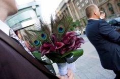 purple calla lilies and peacock feathers! maybe add some white calla lilies